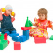 Two children play cubes - Stock Photo