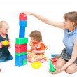 The woman plays with two girls — Stock Photo #1900563