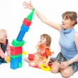 The woman plays with two girls - Stock Photo