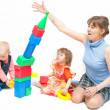 Foto Stock: The woman plays with two girls