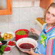 The woman cooks jam - Stock Photo