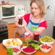 The woman cooks jam — Stock Photo