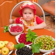 Royalty-Free Stock Photo: The little girl eats a berry