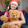 The girl with a soft toy - Foto Stock