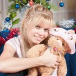 The girl with a soft toy - Stock Photo