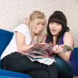 Two girls read magazine — Stock Photo