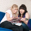 Stock Photo: Two girls read magazine