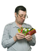 Man holds seeds in firm packing — Stock Photo