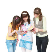 Three girls look magazine — Stock Photo