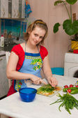 Woman making vegetarian vegetable salad — Stock Photo