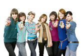 Group of the girls showing mobile phones — Stock Photo