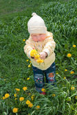 Girl and dandelions — Stock Photo