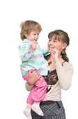 The child dances on hands at mum — Stock Photo