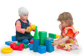 Two children play cubes — Stock Photo