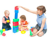 The woman plays with two girls — Stock Photo