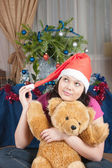 The girl dreams of a Christmas gift — Stock Photo