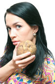 The girl with a crude potato in hands! — Stock Photo