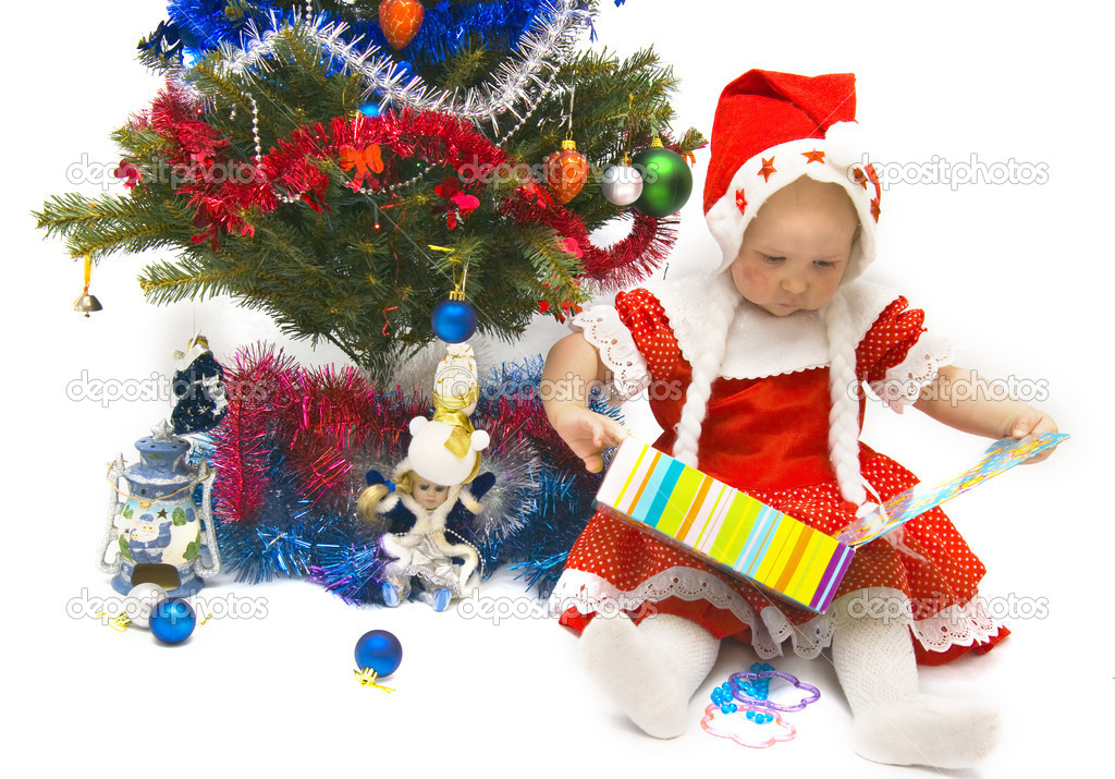 The Image of the little girl near to a fur-tree and gifts — Stock Photo #1900025