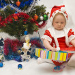 The little girl with Christmas gifts - Stok fotoğraf
