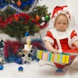 The little girl with Christmas gifts - Photo