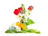 Bouquet of spring flowers in a children's wateri — Stock Photo