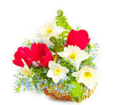 Bouquet of spring flowers in a wattled basket — Stock Photo