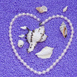 Stock Photo: Heart from pearls on lilac background