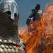 Medieval knights in fire — Stock Photo