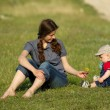 Stock Photo: Mother and the child out doors