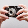 Hands holding an old camera — Stock Photo