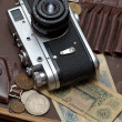 Постер, плакат: Old soviet film camera and money