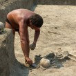 Stock Photo: Archaeologist excavating ancient burial