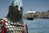 Medieval European knight and sailboat — Stock Photo