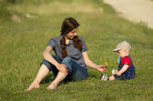 Mother and the child out doors — Stock Photo