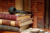 Old russian books smoking pipe and coin — Stock Photo