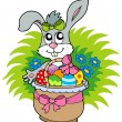 Easter bunny with eggs in basket — Stock Vector