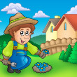 Stock Photo: Gardener planting flowers