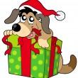 Cute dog in Santas hat - Stock Vector