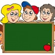 School blackboard with children — Stock Vector