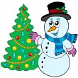 Snowman decorating Christmas tree — Vector de stock