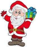 Kerstman met de gift van kerstmis — Stockvector
