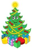 Smiling Christmas tree with gifts — Stock Vector