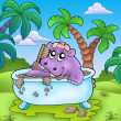 Cute hippo taking mud bath — Stock Photo