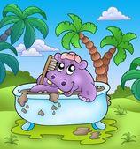 Cute hippo taking mud bath — Stock Photo
