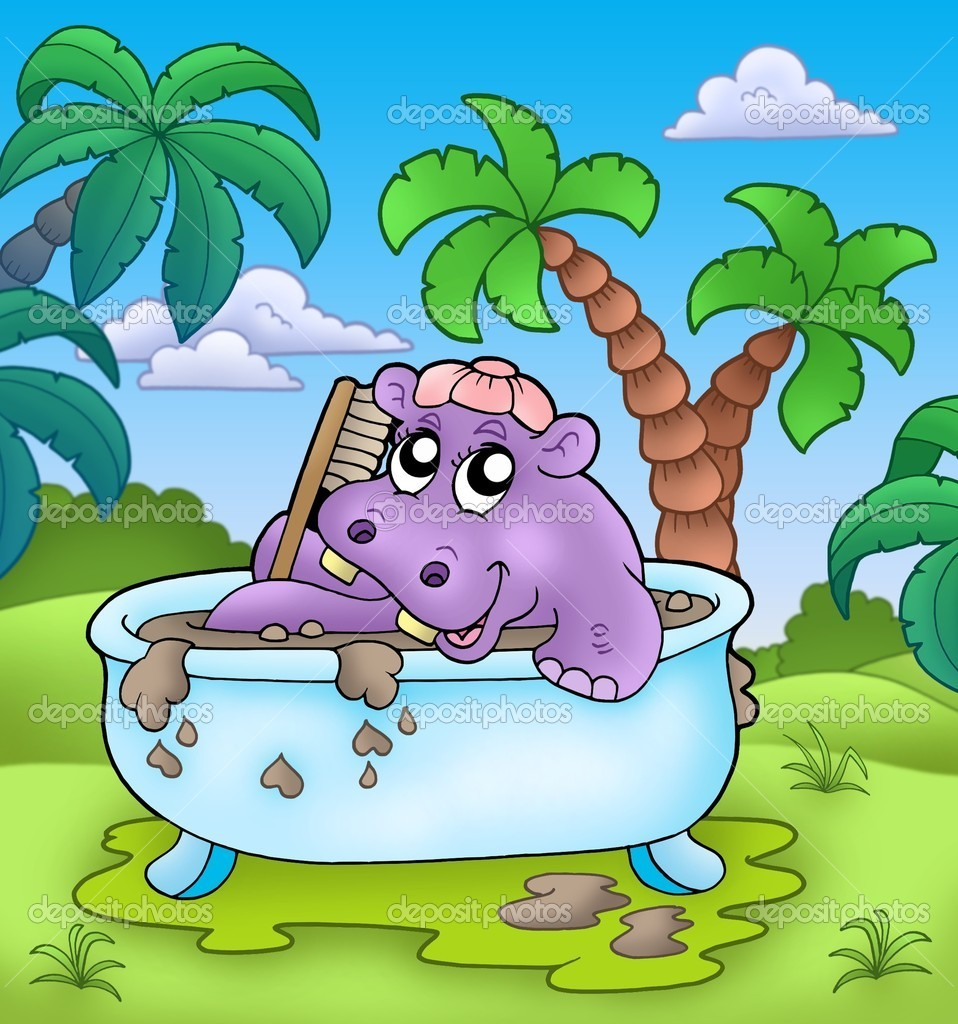 Cute hippo taking mud bath