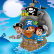 Sailboat with cartoon pirates at night - Stock Photo