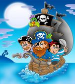 Sailboat with cartoon pirates at night — Stock Photo