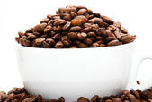 Mug filled with coffee beans — Stock Photo