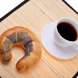 Stock Photo: Crescent roll and coffee