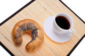 Crescent roll and coffee — Stock Photo